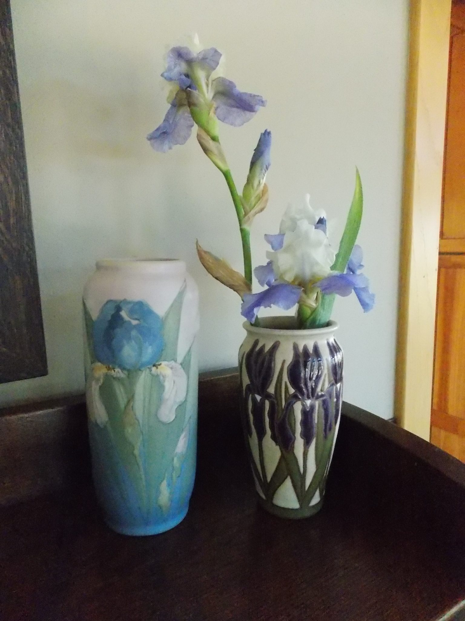 An arts and crafts garden retreat arts and crafts collector leave some of our iris stalks bent and broken leigh ann carefully gathers them up and brings them indoors selecting just the right vases for them reviewsmspy